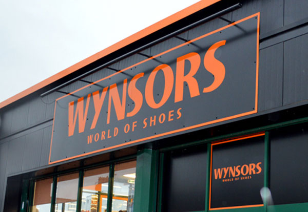 Close-up of logo on a Wynsors World of Shoes building